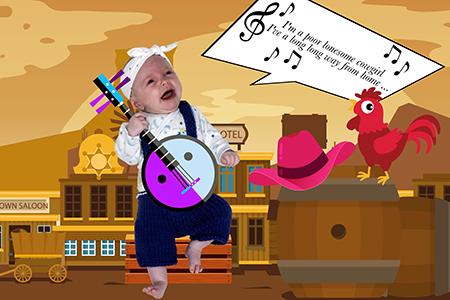 un joli bébé dans un western jouant du banjo par notre photographe Rachel Joubi